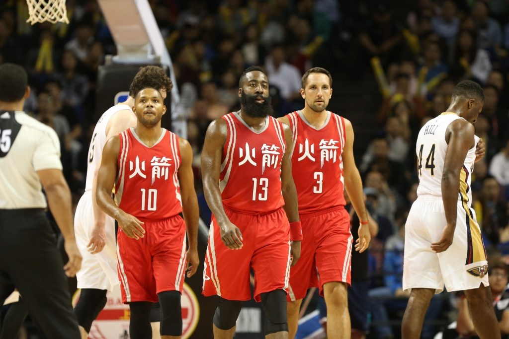 SHANGHAI, CHINA - OCTOBER 9: Eric Gordon #10, James Harden #13 and Ryan Anderson #3 of the Houston Rockets takes in the game against the New Orleans Pelicans as part of the 2016 Global Games - China at the Mercedes Benz Arena on October 9, 2016 in Shanghai, China. NOTE TO USER: User expressly acknowledges and agrees that, by downloading and/or using this photograph, user is consenting to the terms and conditions of the Getty Images License Agreement. Mandatory Copyright Notice: Copyright 2016 NBAE (Photo by Joe Murphy/NBAE via Getty Images)