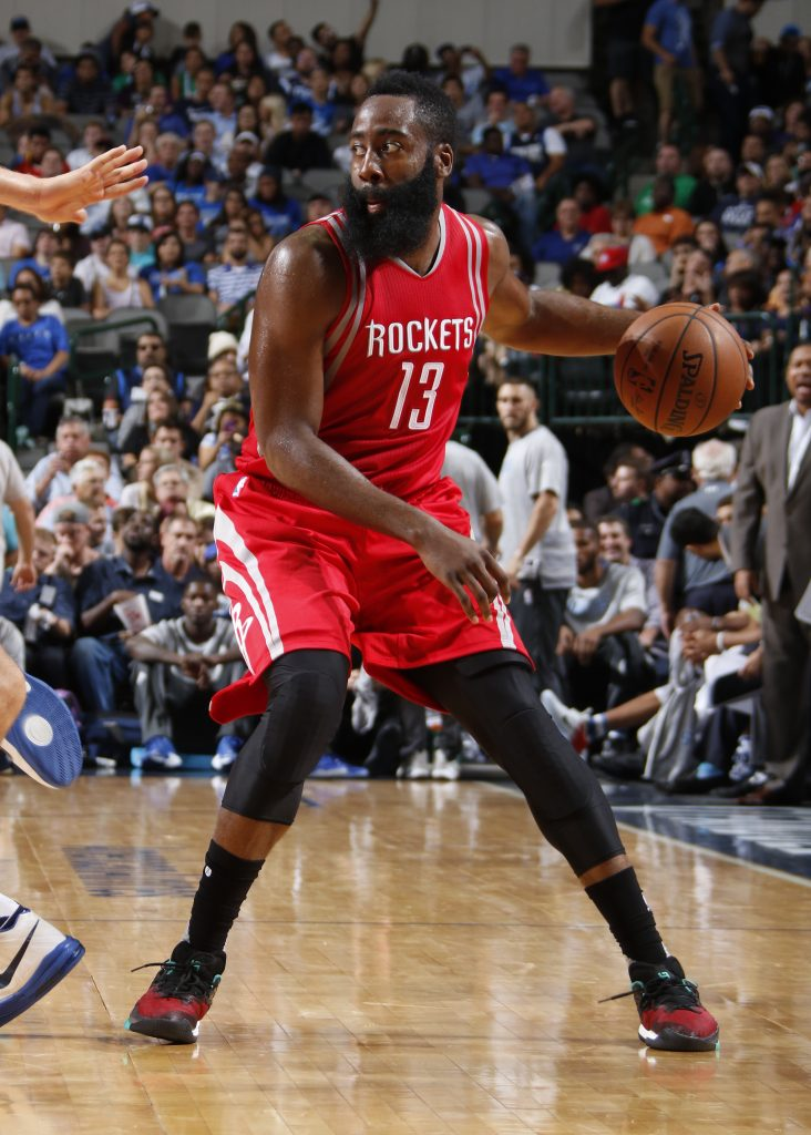 DALLAS, TX - OCTOBER 19: James Harden #13 of the Houston Rockets handles the ball against the Dallas Mavericks during a preseason game on October 19, 2016 at the American Airlines Center in Dallas, Texas. NOTE TO USER: User expressly acknowledges and agrees that, by downloading and or using this photograph, User is consenting to the terms and conditions of the Getty Images License Agreement. Mandatory Copyright Notice: Copyright 2016 NBAE (Photo by Danny Bollinger/NBAE via Getty Images)